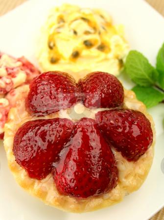 Strawberry Custard Tart  stock photo, Strawberry custard tart with passionfruit cream and cranberry cream with a mint garnish. by Brett Mulcahy
