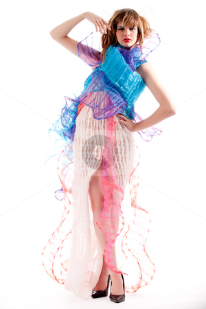 Teenage girl in a stylised dress striking a pose stock photo, Studio portrait of a teenage girl stylising a pose by Frenk and Danielle Kaufmann