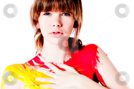 Teenage girl designing her own body paint stock photo, Studio portrait of a teenage girl painting herself by Frenk and Danielle Kaufmann