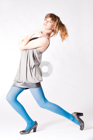 Teenager in blue pantyhose and grey blouse posing stock photo, Studio portrait of a cute teenager by Frenk and Danielle Kaufmann