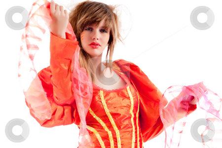 Cute teenage girl presenting her orange fancy dress  stock photo, Studio portrait of a girl in a special stylised dress by Frenk and Danielle Kaufmann