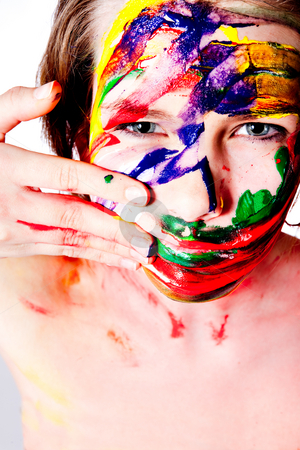 Making a mess of myself with wet paint. stock photo, Studio portrait of a teenage girl painting herself by Frenk and Danielle Kaufmann