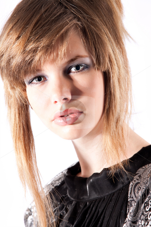 Close-up of a beautiful teenage girl in classical dress stock photo, Studio portrait of a cute teenage girl in a classical dress by Frenk and Danielle Kaufmann