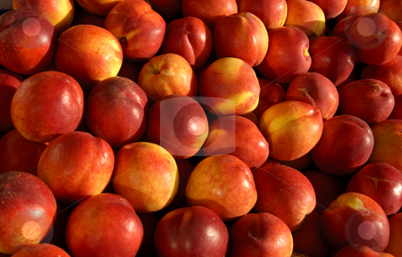 Peaches stock photo, Close-up of ripe peaches on a French market stall, in the early morning light. by Alistair Scott