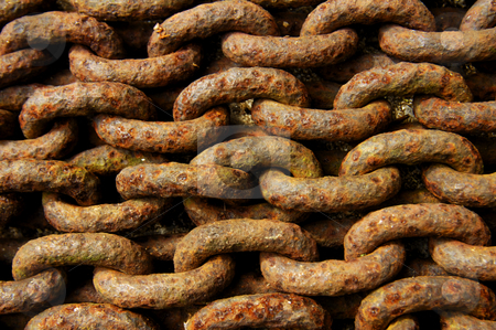 Chain stock photo, Macro of a pile of rusty iron chain. Suitable for abstract background. by Alistair Scott
