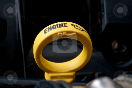 Shallow focus close-up of a yellow engine oil dipstick stock photo, Shallow focus close-up of a yellow engine oil dipstick by Vince Clements