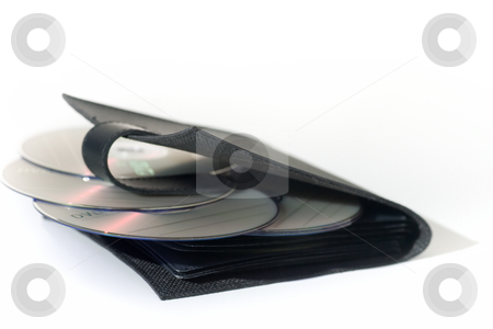 CD Case, isolated on white stock photo, A black leather CD/DVD wallet with scattered DVD media, isolated on white. by Kevin Woodrow