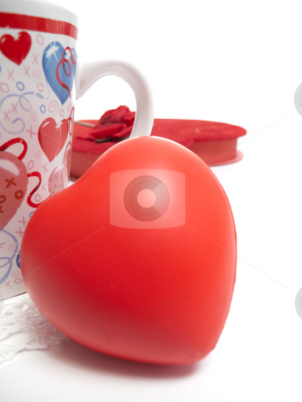 Mug, Heart and box of chololates stock photo, A red valentines day heart beside a coffee mug, with a box of chocolates in the backgrouxod. by Kevin Woodrow