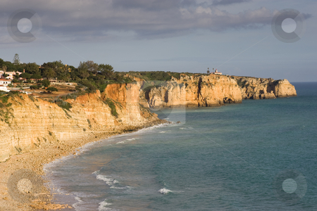 Portugal Coastline stock photo, The cliffs and coastline of Portugal, with the town of Lagos in the distance. by Kevin Woodrow