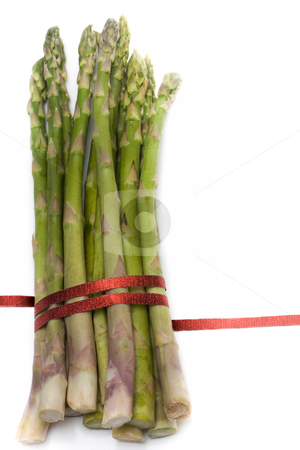 Asparagus with ribbon stock photo, A bunch of asparagus, tied with red ribbon, isolated on white. by Kevin Woodrow