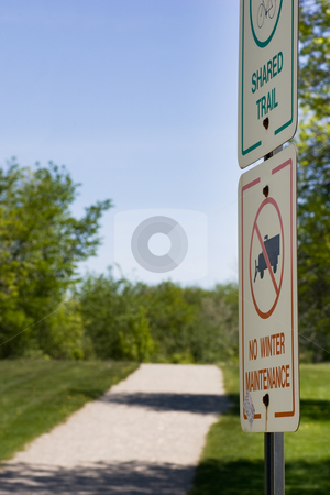 Signs along the pathway stock photo, Focus on two signs which line a trail, indicating
