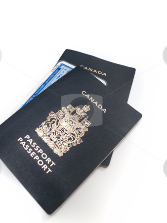 Canadian Passports and Birth Certificate stock photo, Two Canadian passports with a laminated birth certificate, isolated on white. by Kevin Woodrow