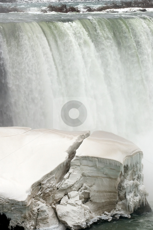 Winter at the falls stock photo, Niagara Falls, on the Canadian side, with a cracking ice/snow formation. by Kevin Woodrow