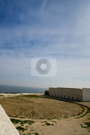 Breese meter stock photo, What's left of an ancient windrose, part of a fortress just outside Sagres, Portugal, in the Algarve. by Kevin Woodrow
