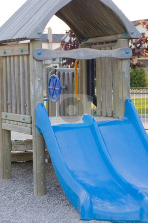 Kids play equipment stock photo, Kids play area, focus on a blue slide. by Kevin Woodrow