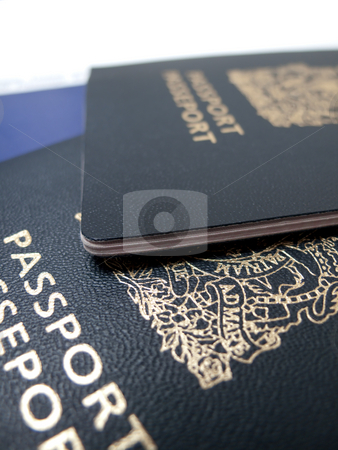 Travel Documents stock photo, A closeup of two passports, isolated on white. by Kevin Woodrow
