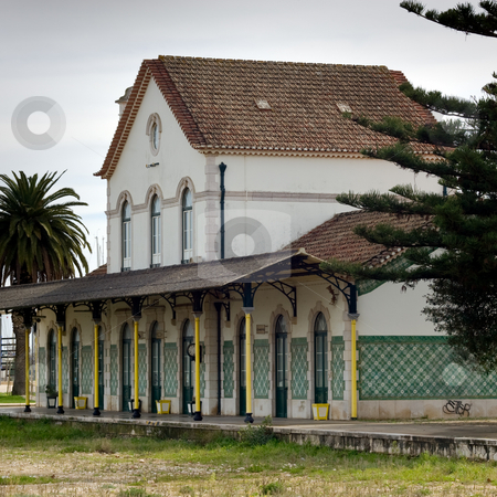 Abandoned Railway Station stock photo, An abandoned railway station with open space in front, where railway tracks once sat.  Lagos, Portugal. by Kevin Woodrow