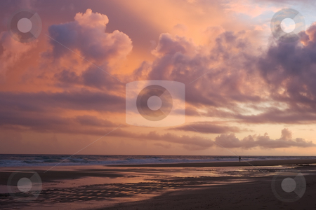 Sunset cloud color stock photo, A sunset along the beaches of Lagos, Portugal, with a clouded backlit sky. by Kevin Woodrow