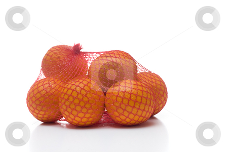Oranges in netting stock photo, A bunch of oranges packaged in red netting, isolated on white. by Kevin Woodrow