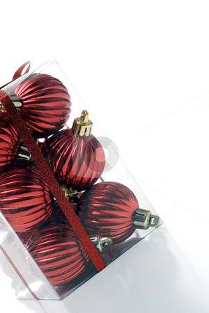 Bunch of boxed ornaments stock photo, A package of christmas ornaments, packaged in a clear plastic box, wrapped in ribbon, angled, and isolated on white. by Kevin Woodrow
