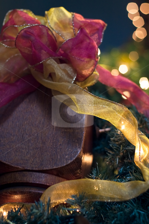 Decorating the Banister stock photo, Closeup of various colors of ribbon and garland, as they decorate the end of a banister. by Kevin Woodrow