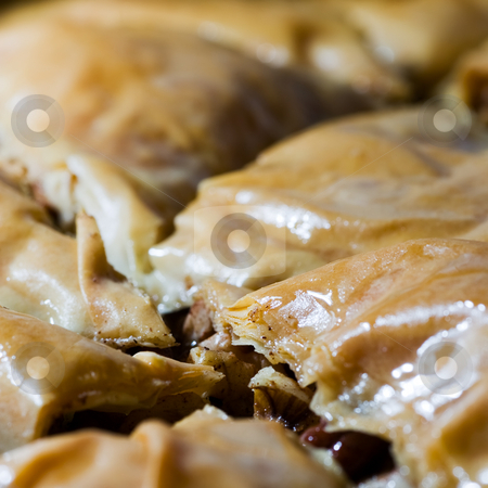 Tray of Baklava stock photo, A closeup of a tray of Baklava, a sweet greek pastry dessert. by Kevin Woodrow