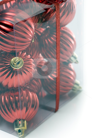 Bunch of boxed ornaments closeup stock photo, A package of christmas ornaments, packaged in a clear plastic box, wrapped in ribbon, and isolated on white. by Kevin Woodrow