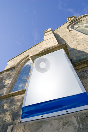 Church and blank banner stock photo, A blank banner hanging on the outside of a church, looking up towards the sky.  Guelph, Ontario, Canada by Kevin Woodrow