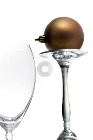 Christmas ornament series stock photo, Champagne glasses with a single christmas ornament, isolated on white. by Kevin Woodrow