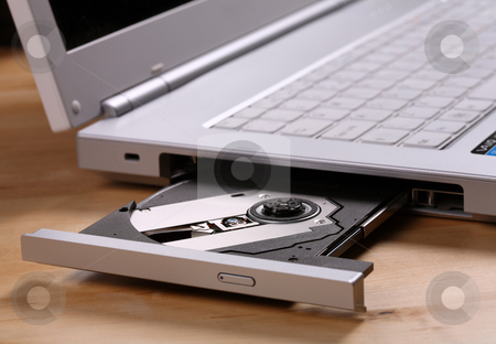 Laptop with CD / DVD tray open and ready for a disc stock photo, Laptop with cd / DVD tray open ready for work by Mark Allchin