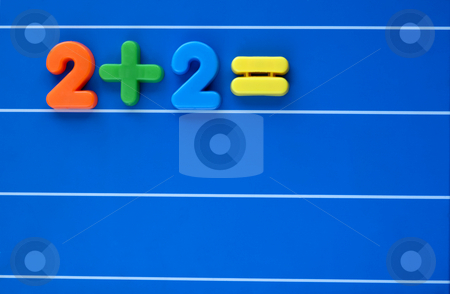 Two plus two is? stock photo, A sum, from a child's toy number set, placed on a blue, lined background. Answer left blank. Space for text elsewhere in the image. by Alistair Scott