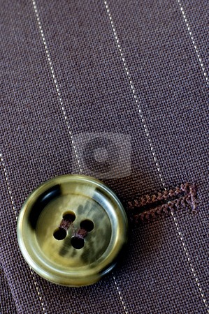 Buttonhole stock photo, Macro of a buttonhole in a businessman's pin-stripe suit. Texture and light. by Alistair Scott