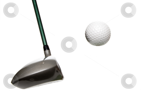 Golfing stock photo, A driver just before it hits a golf ball. by Robert Byron
