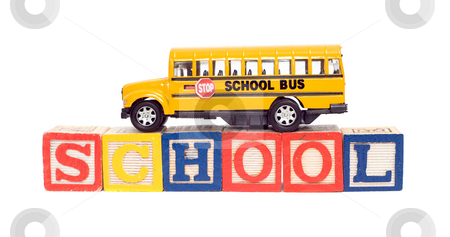 Education Concept stock photo, Concept image of education using a toy school bus and baby letter blocks, isolated against a white background by Richard Nelson