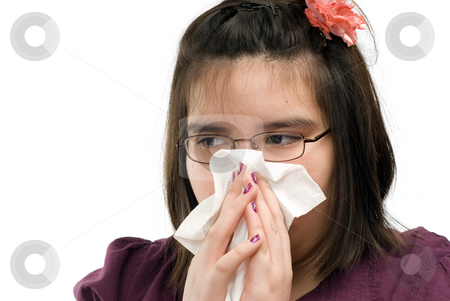 Girl Blowing Nose stock photo, Closeup view of a young girl blowing her nose, isolated against a white background by Richard Nelson