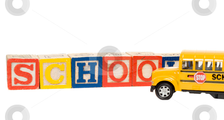 School Concept stock photo, School concept with baby blocks spelling the word school and a yellow school bus by Richard Nelson