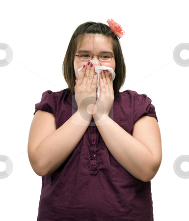 Coughing Child stock photo, A young girl holding a tissue to her mouth while she is coughing, isolated against a white background by Richard Nelson