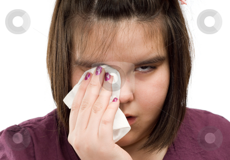 Crying Girl stock photo, Closeup view of a young girl wiping tears from her eyes with a tissue by Richard Nelson