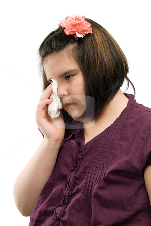 Sad Child stock photo, A sad girl is wiping her eyes with a tissue, isolated against a white background by Richard Nelson