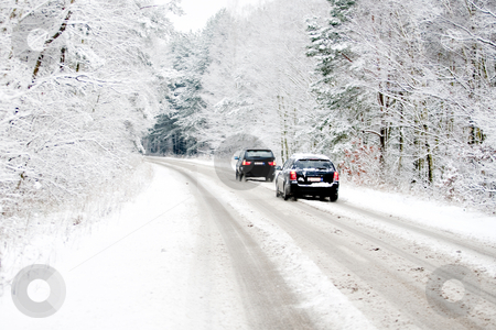 Cars on a white winter road stock photo, Belgium in winter, cars driving over a snow covered street by Frenk and Danielle Kaufmann