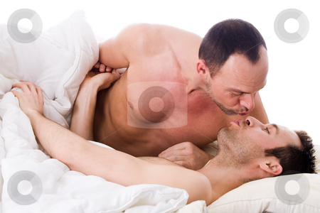 He gets his kiss stock photo, Happy homo couple in a white bed taking care of his boyfriend by Frenk and Danielle Kaufmann