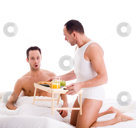 Breakfast on bed stock photo, A Happy homo couple and their breakfast on a tray in bed by Frenk and Danielle Kaufmann