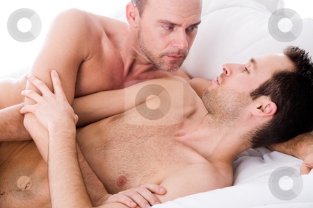 Hugging men couple stock photo, Happy homo couple in a white bed taking care of his boyfriend by Frenk and Danielle Kaufmann