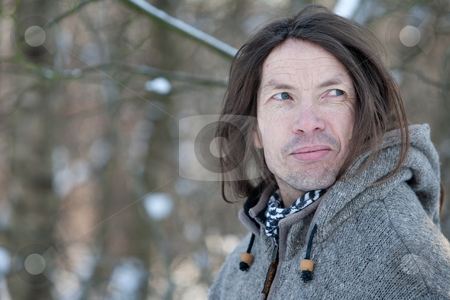 Character face in winter scape stock photo, Man with characteristic face standing in a winter landscape by Frenk and Danielle Kaufmann