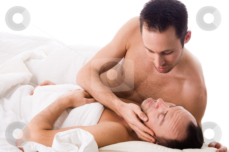 My sweet boyfriend stock photo, Happy homo couple in a white bed taking care of his boyfriend by Frenk and Danielle Kaufmann
