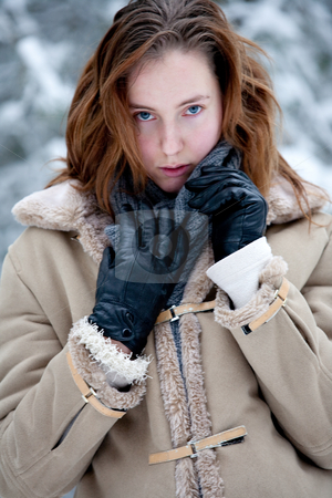 Winter landscape woman looking at you stock photo, A young woman in a winter landscape looking at you by Frenk and Danielle Kaufmann