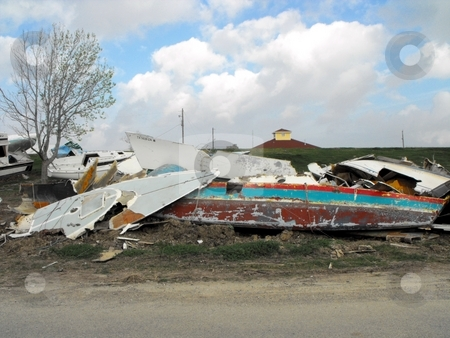 Destroted boats stock photo, Wreckage of boats after hurricane Ike hit Pleasure Island, Port Arthur, Texas by Robert Brown