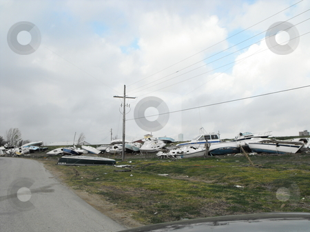Boats on a dike stock photo, Boats left on a dike after Hurricane Ike Hit Pleasure Island, Port Arthur, Texas by Robert Brown
