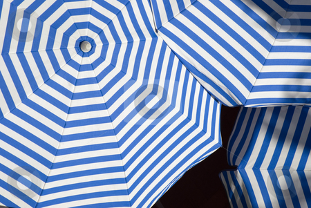 Sun Shade stock photo, Overlapping sun shade umbrellas with white and blue stripes by Stephen Gibson