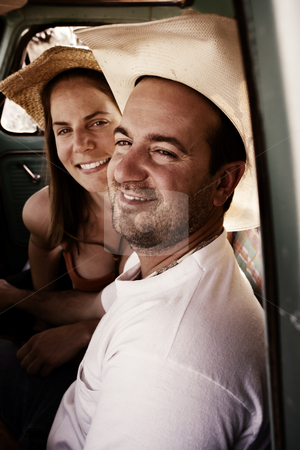 Cowboy and woman in pickup truck stock photo, Portrait of Cowboy and woman in pickup truck cab by Scott Griessel